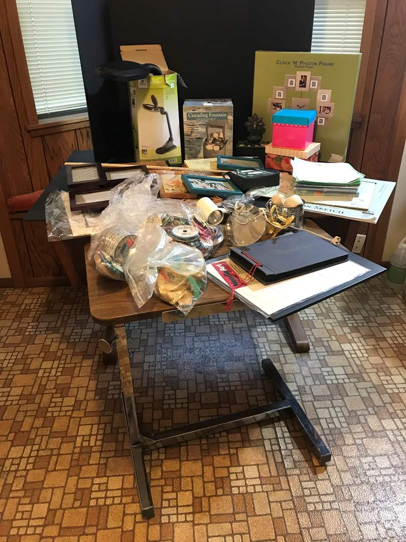 Lot # 298 - Crafting Items: Small Crafting Table on Wheels, Paper, Ribbon, Wall Art, Frames & More.. (main image)