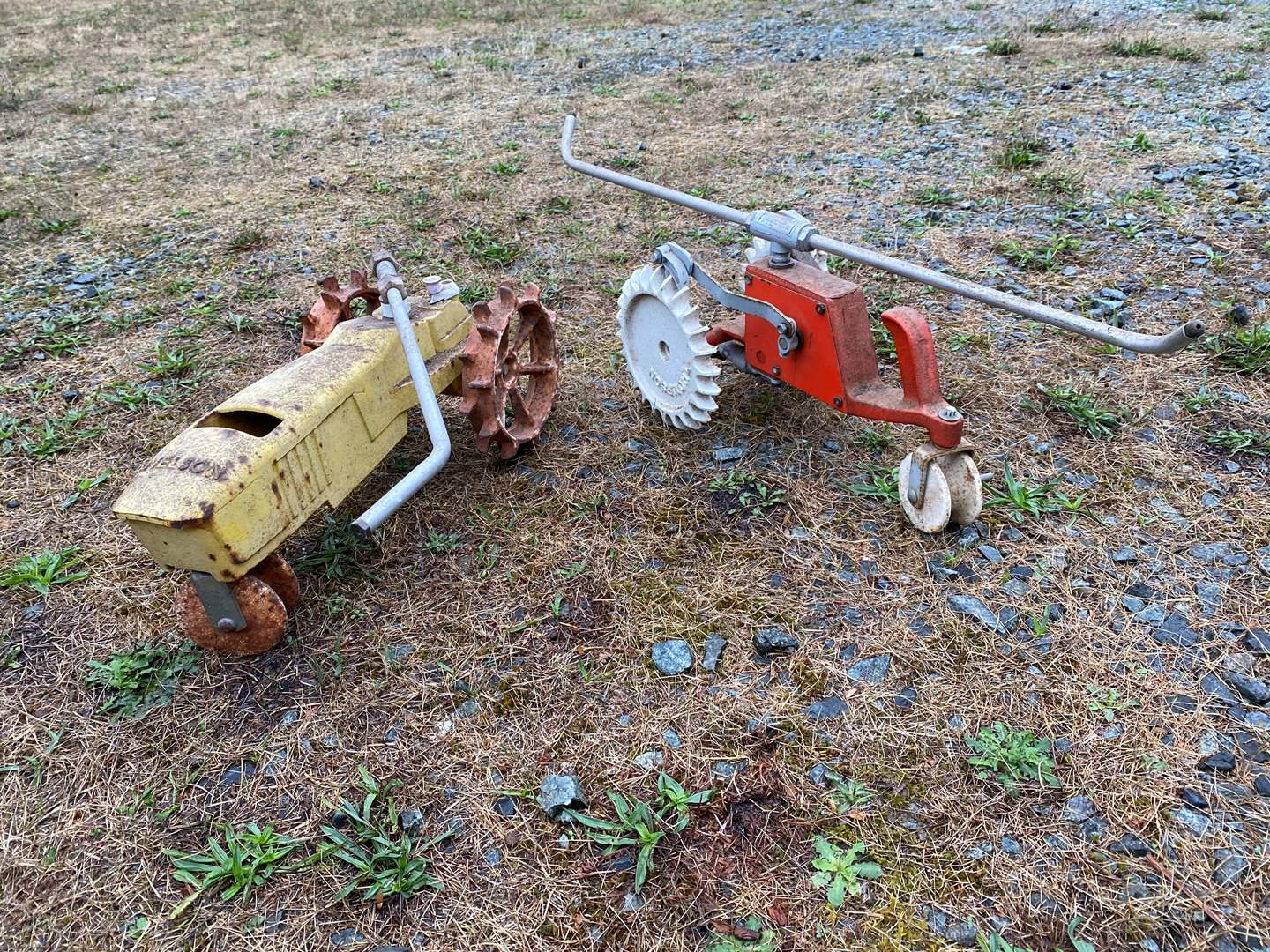 "Lot # 308 - Two Vintage Metal Tractor Sprinklers ""Nelson & Thompson""  (main image)"