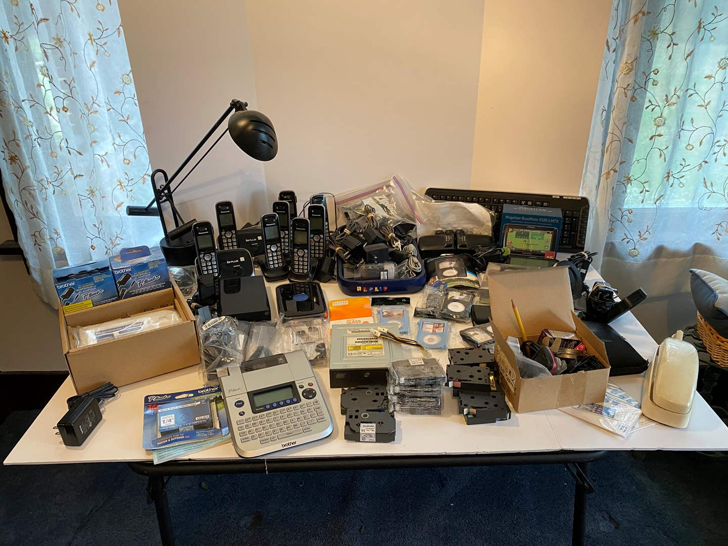 Lot # 6 - Brother P-Touch Label Makers, Panasonic Cordless Phones, Cell Phone Cases & Holders, iPod Cases & More.. (main image)
