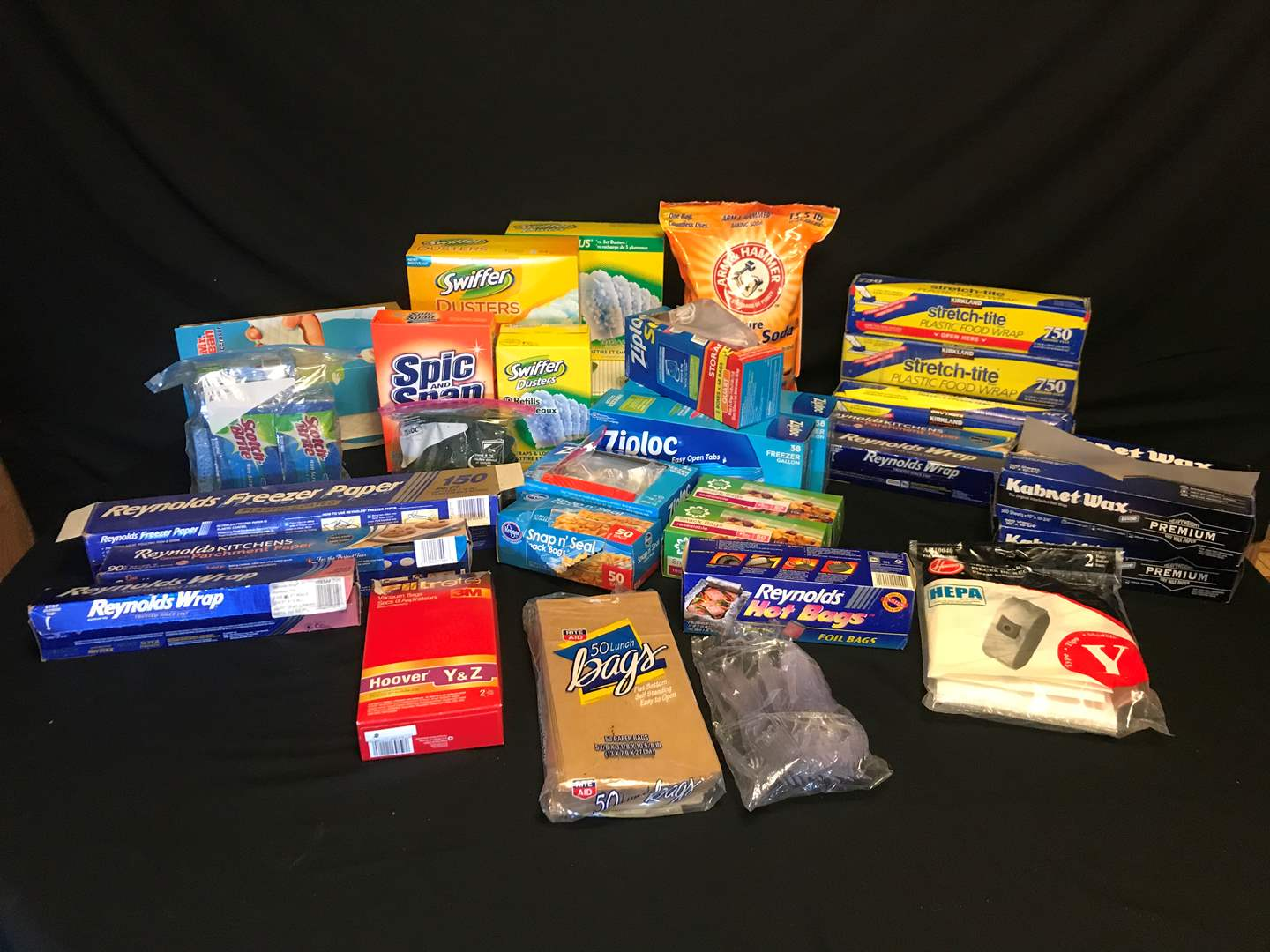 Lot # 52 - Selection of New & Used Items: Ziploc Bags, Swifter Duster & Refills, Sponges, Plastic Wrap & More.. (main image)