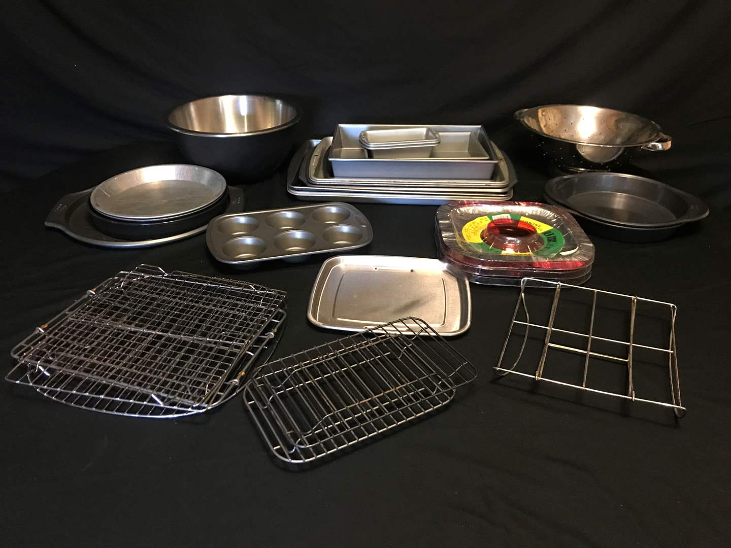 Lot # 53 - Cookie Sheets, Cake & Pie Pans, Strainer, Mixing Bowl, Misc. Racks & More.. (main image)
