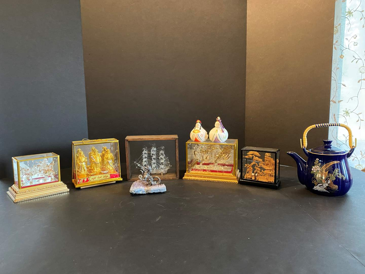 Lot # 15 - Glass Asian Figurines in Display Case/Boxes, Wood Asian Scene, Teapot & More.. (main image)