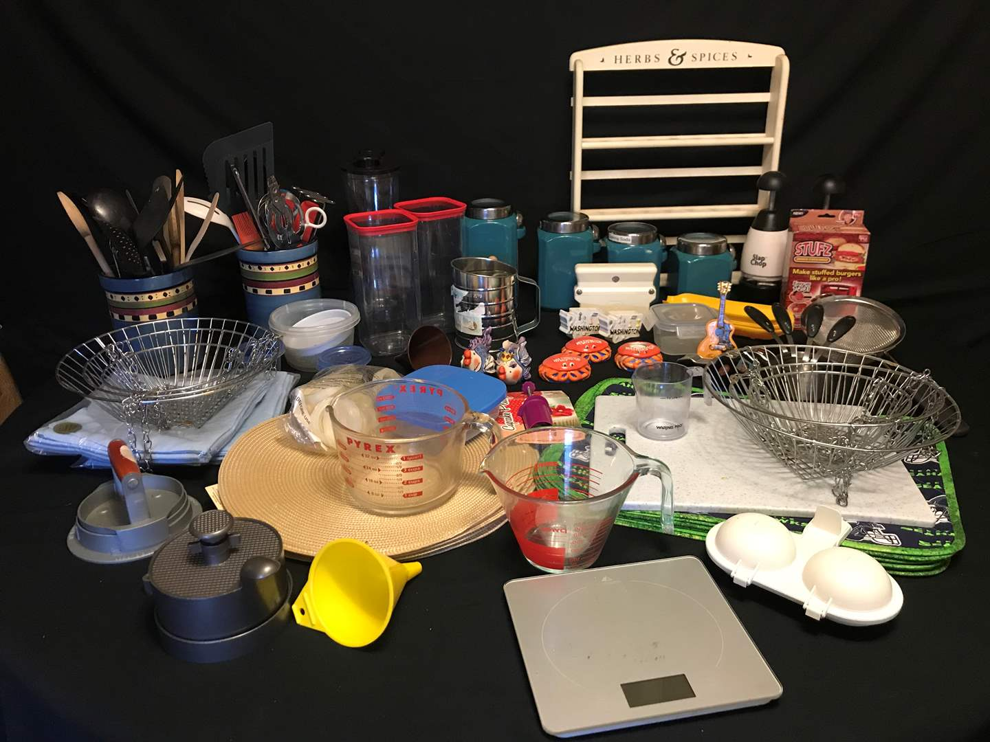 Lot # 58 - Selection of Kitchen Items: Canisters, Spatulas, Place Mats, Measuring Cups, Salt & Pepper Shakers & More.. (main image)