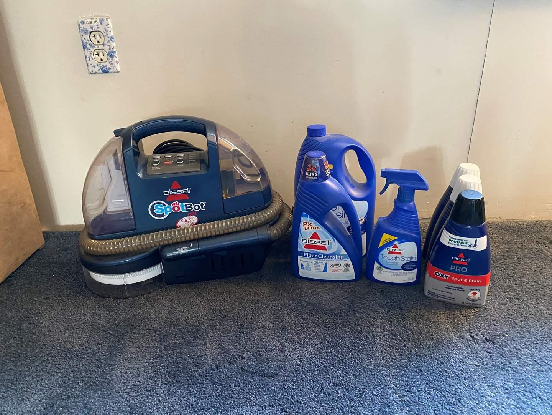 Lot # 43 - Bissell SpotBot Pet Carpet Cleaner w/Bottles of Cleaner (main image)