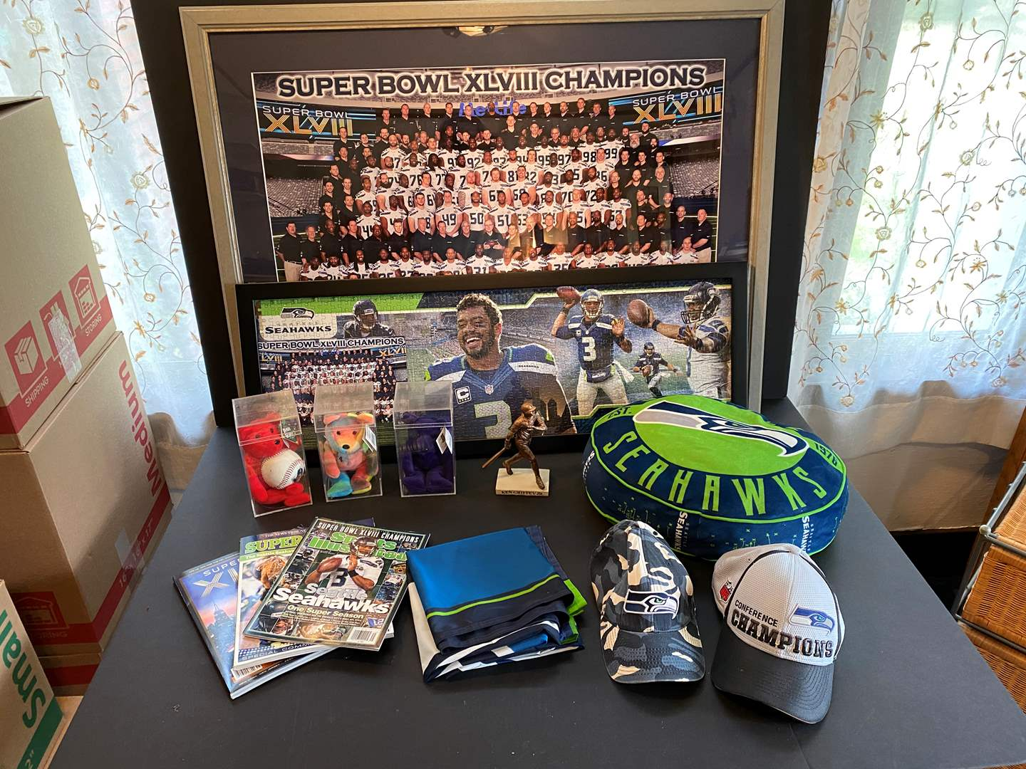 Lot # 97 - Framed Seahawks Poster, Puzzle, Mariners Beanie Babies, Seahawks Hats & More.. (main image)