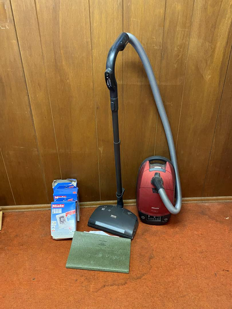 Lot # 116 - Miele Red Velvet Power Plus Vacuum w/Bags (main image)