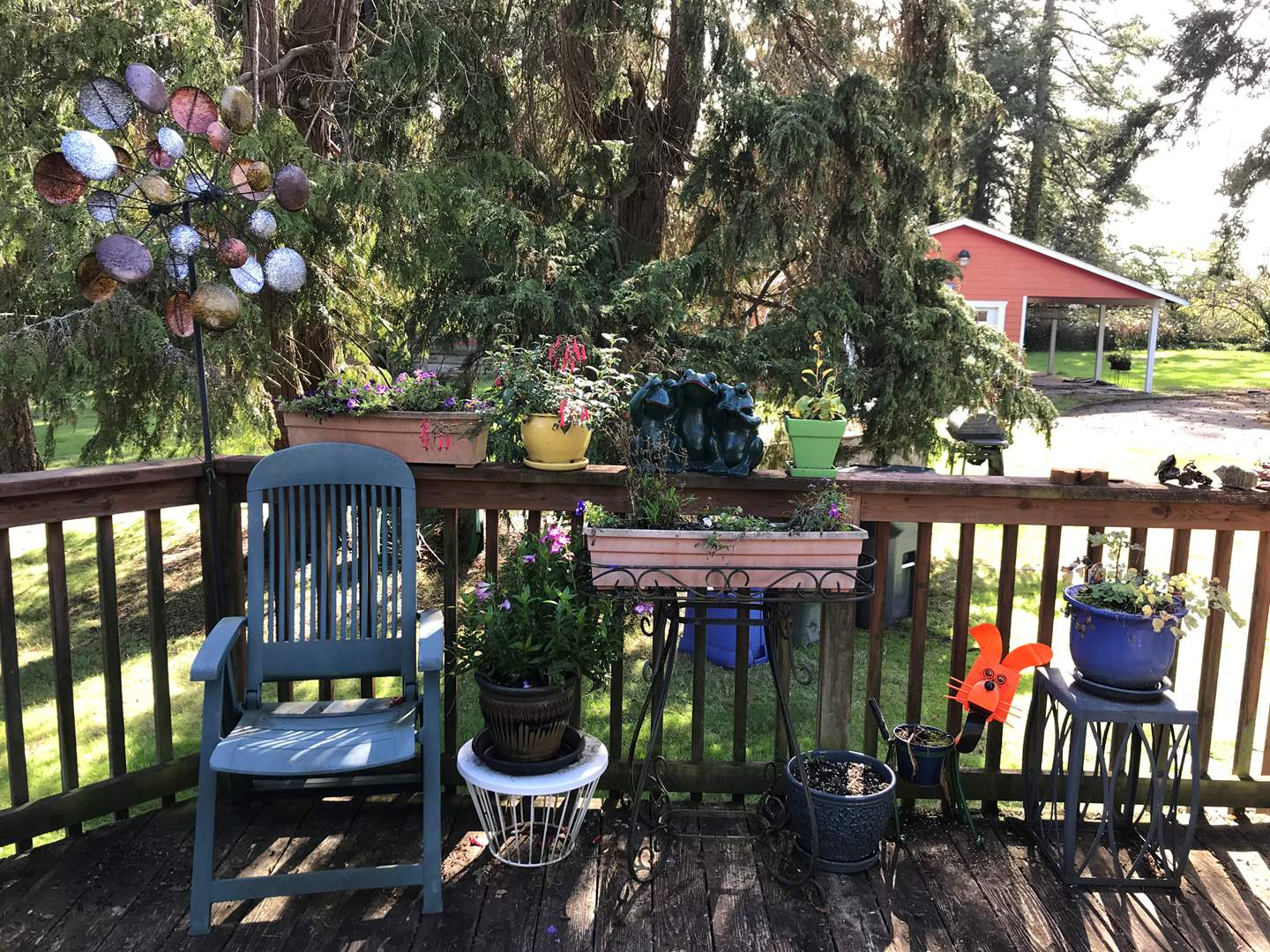 Lot # 127 - Plants, Windmill, Lawn Chair & Plant Stands (main image)