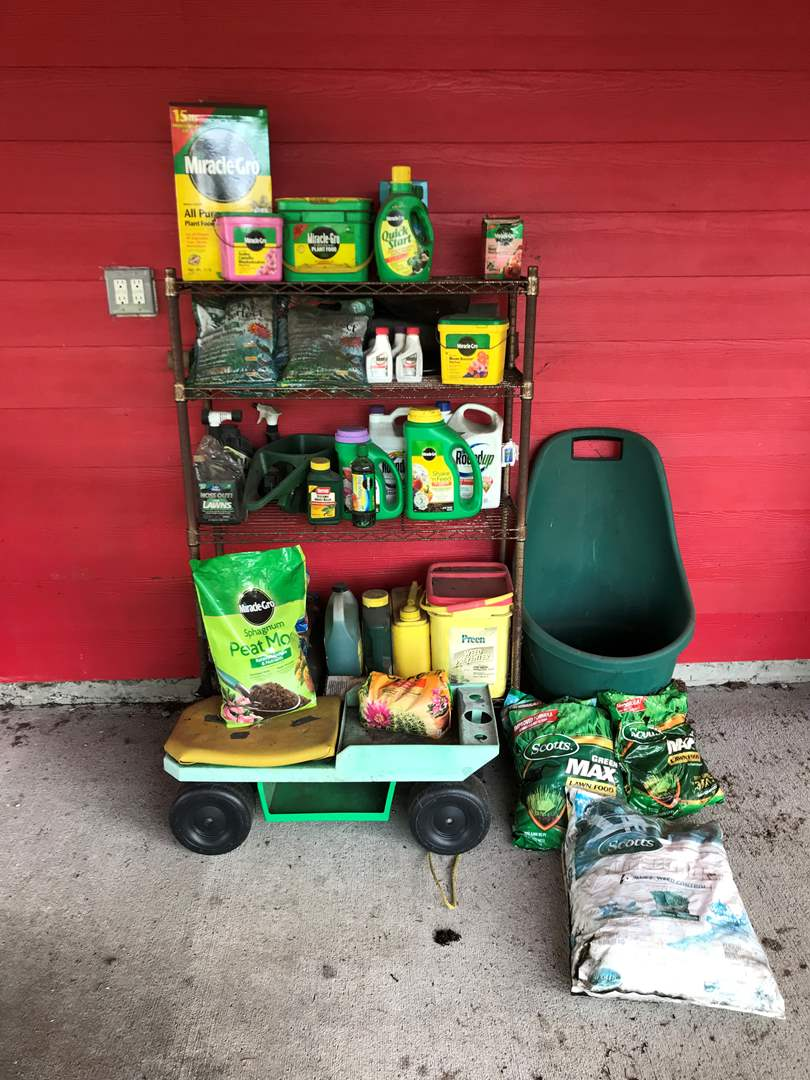 Lot # 130 - Gardening Items: Miracle Gro Plant Food, Bloom Booster, Quick Start, Azalea Food, Round Up, Garden Cart & More.. (main image)