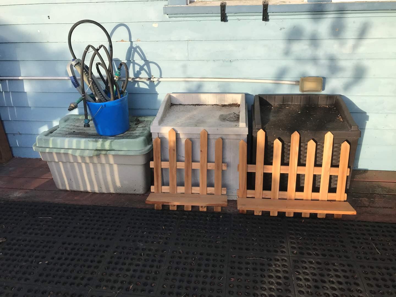 Lot # 136 - 2 Suncast Outdoor Storage Bins & One Tub w/Gardening Supplies  (main image)