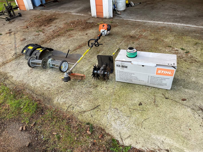 Lot # 159 - Stihl KM-130R Multi Tool Trimmer w/Tiller, Brush & Dethatcher Attachments - Works (main image)