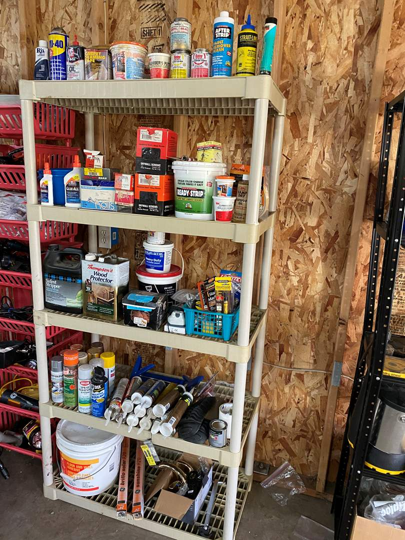 Lot # 168 - Plastic Shelf Filled w/Paints, Chemicals, Hardware, Hot Glue Gun, Calking, Tools & More.. (main image)