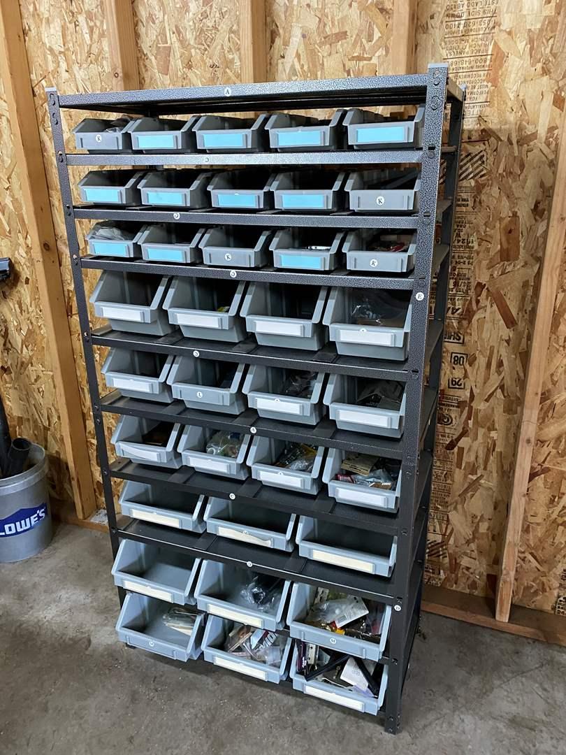 Lot # 184 - Metal Rack w/Storage Bins Full of Hardware (main image)