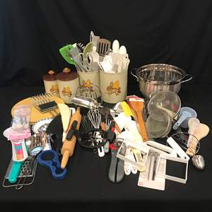 Lot # 81 - Large Lot of Kitchen Utensils, Spoons, Wisks, Rolling Pin, Strainers, Measuring Cups & More..