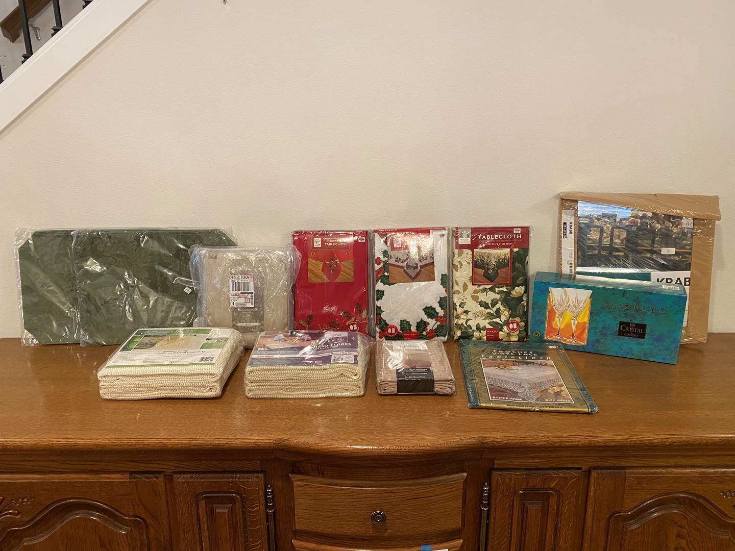 Lot # 151 - Brand New Items: Table Cloths, Curtains, Crystal, Placemats, Non-Slip Rug Pads & More..  (main image)