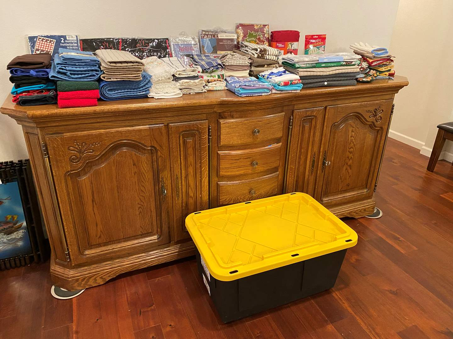 Lot # 152 - Large Bin Full of New & Used Pot Holders, Table Cloths, Drying Mats, Dish Towels, Aprons & More.. (main image)