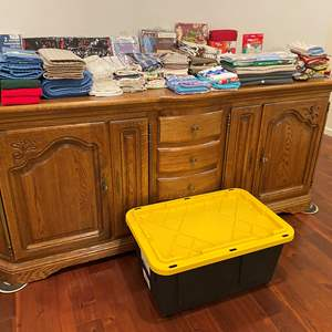 Lot # 152 - Large Bin Full of New & Used Pot Holders, Table Cloths, Drying Mats, Dish Towels, Aprons & More..