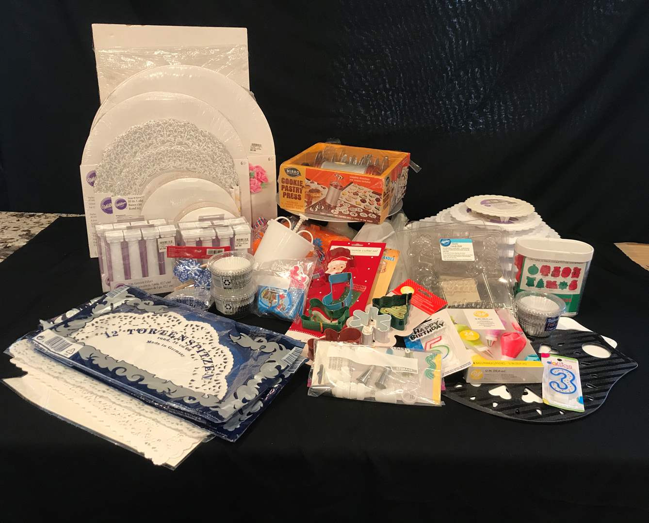 Lot # 217 - Nice Selection of Cake Decorating Items, Cake Circles, Plastic Separator Plates/Pillars, Cookie Cutters & More.. (main image)