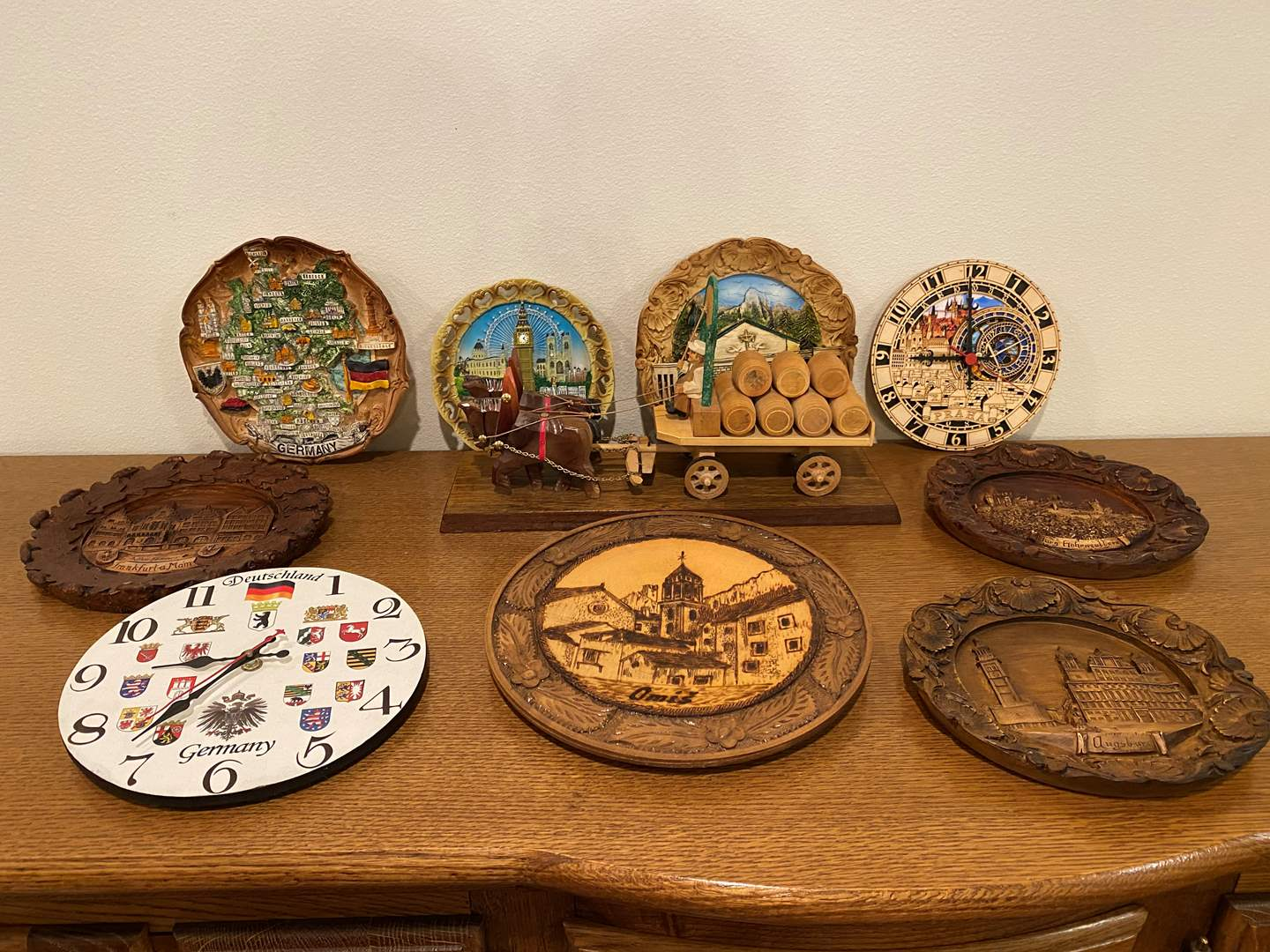 Lot # 198 - Wood & Resin Carved Wall Art, German Clocks, Wood Horse Drawn Carriage & More.. (main image)