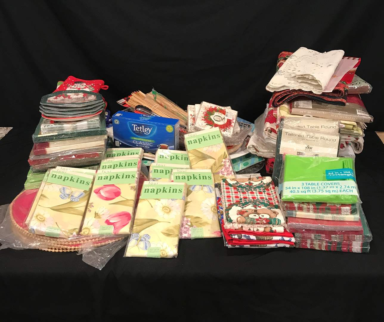 Lot # 222 - Selection of Cloth & Paper Napkins, Table Cloths of Various Sizes, Plastic Serving Trays, Tetley Black Tea & More.. (main image)