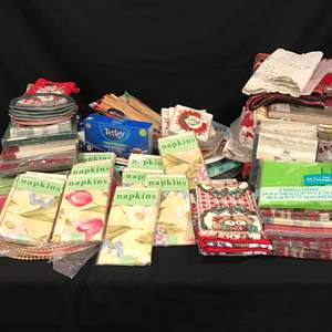 Lot # 222 - Selection of Cloth & Paper Napkins, Table Cloths of Various Sizes, Plastic Serving Trays, Tetley Black Tea & More..