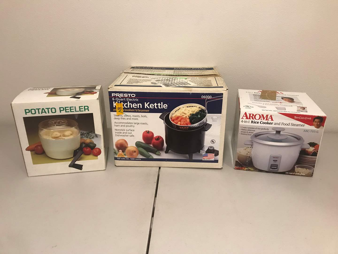 Lot # 280 - New in Box Items: Aroma 4-in-1 Rice Cooker, Presto 6 Quart Kitchen Kettle & Potato Peeler (main image)