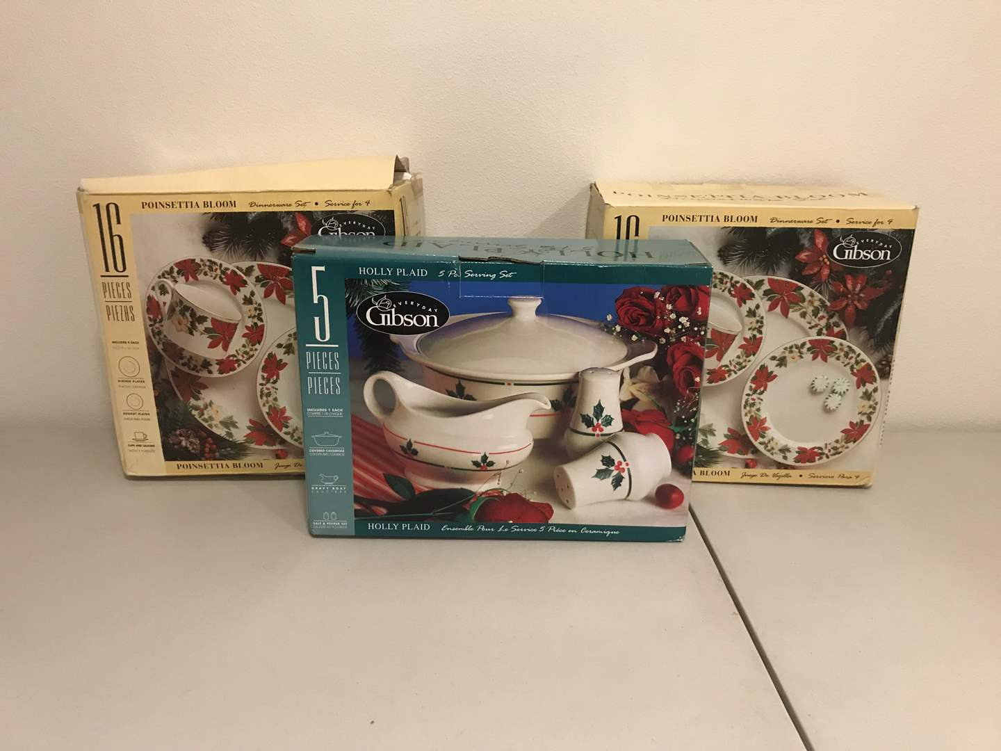 Lot # 285 - Two New in Box 16 Piece Set of Gibson Poinsettia Bloom Dishes & New in Box Gibson Holly Plaid Serving Set  (main image)