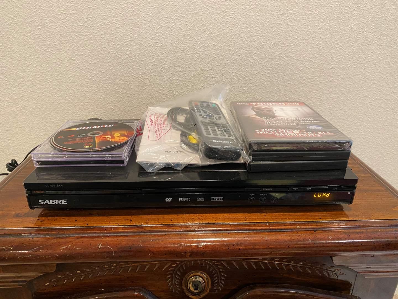 Lot # 274 - Sabre DVD Player w/DVD's (main image)