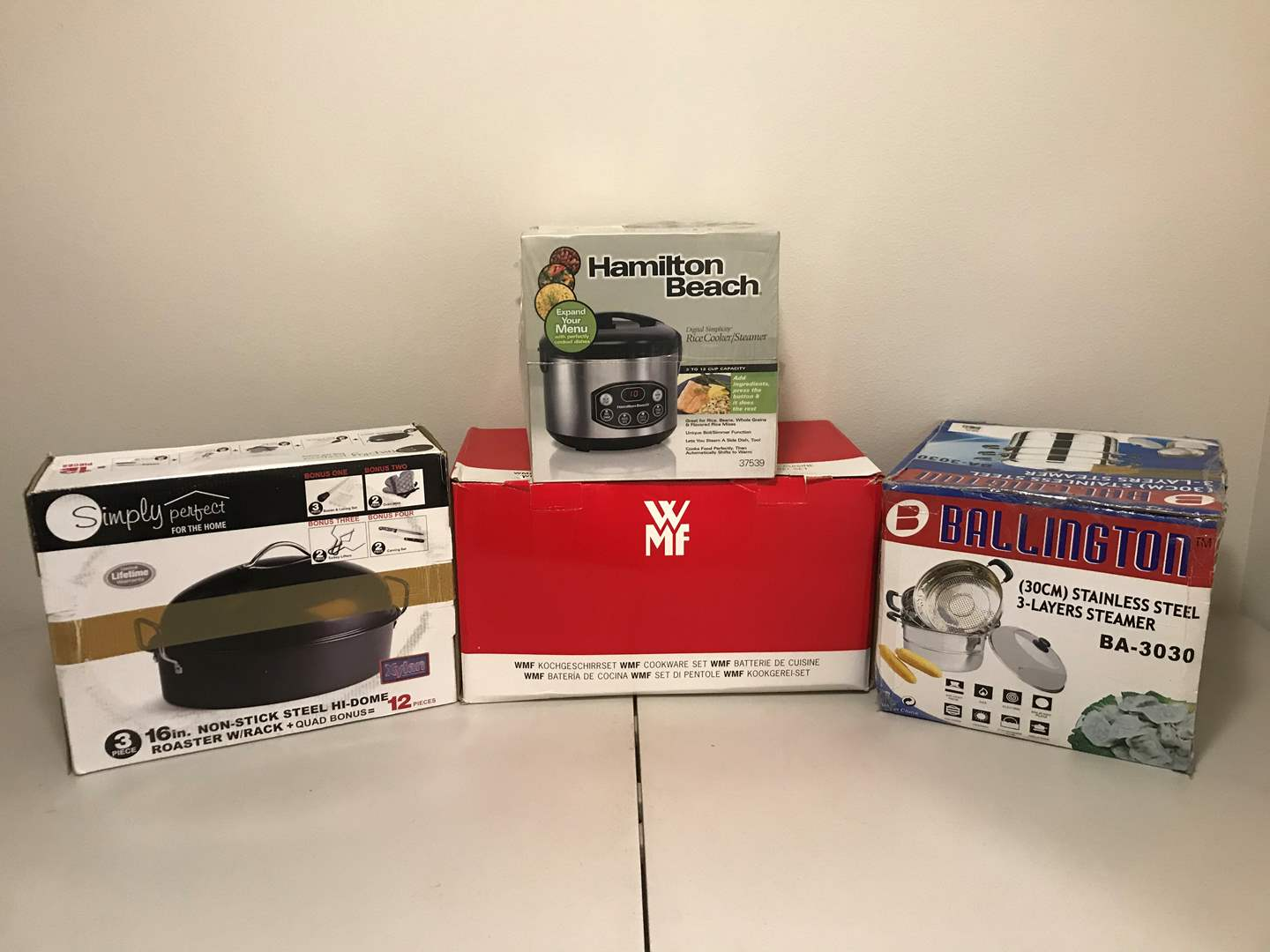 Lot # 288 - New in Box Simply Perfect Roasting Pan, WMF 6 Piece Pot Set, Ballington 3 Layer Steamer, Hamilton Beach Rice Cooker (main image)