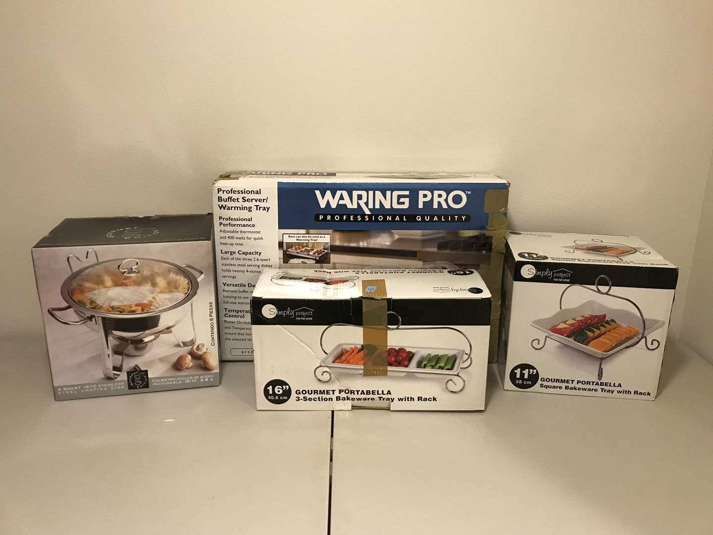 Lot # 292 - New in Box Waring Pro Professional Buffet Server, Gourmet Edition Chafing Dish & 2 Simply Perfect Serving Dishes (main image)
