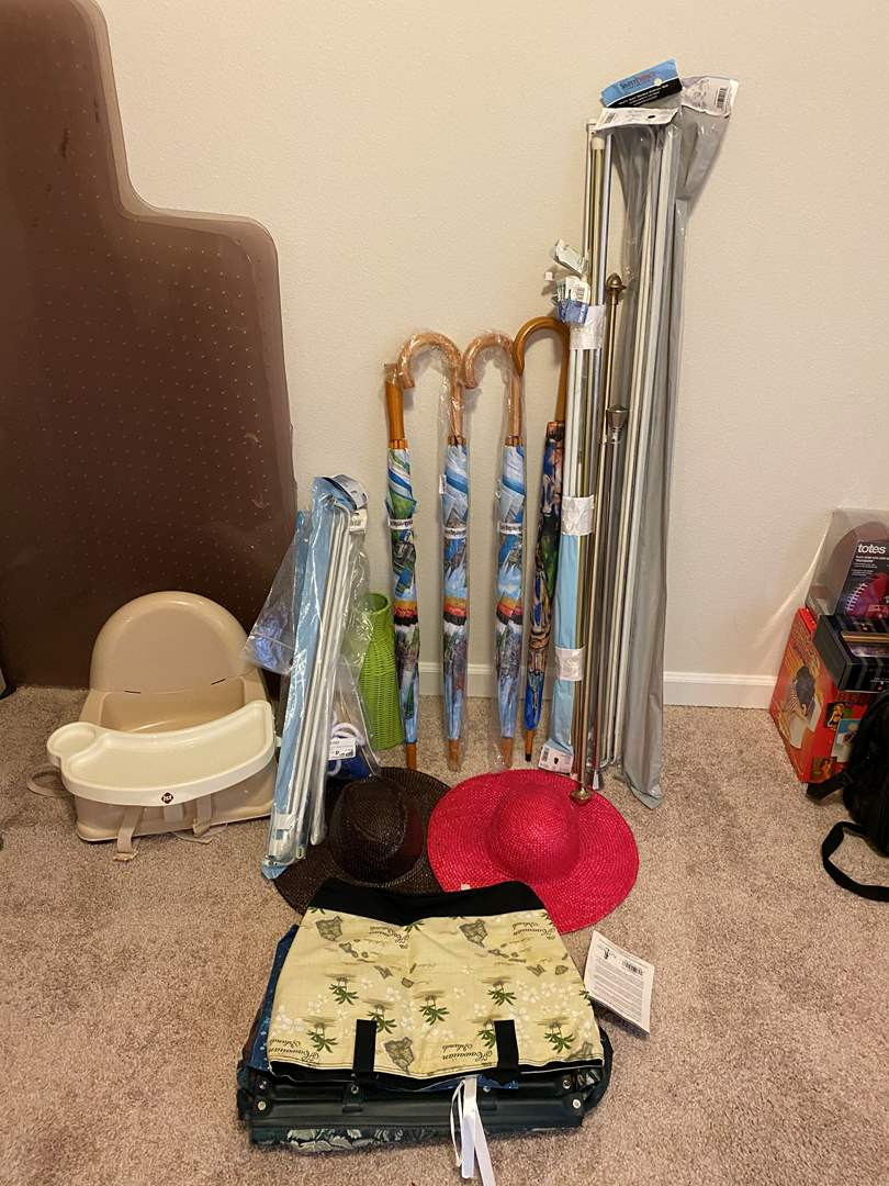 Lot # 373 - Misc. New Curtain Rods, Umbrellas, Handbags, Kids Seat & More.. (main image)