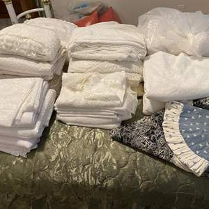 Lot # 376 - Nice Selection of new and used lace curtains and table cloths.