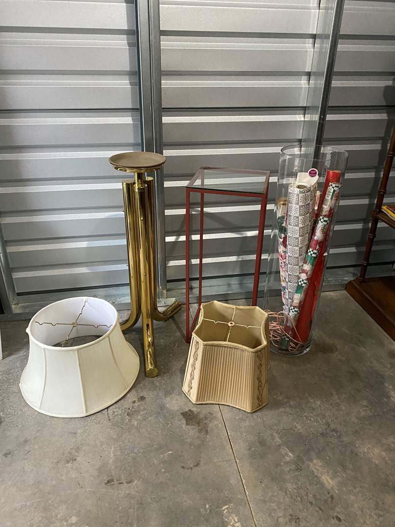 Lot # 19 - Plant Stands, Lamp Shades, Large Glass Vase w/Wrapping Paper (main image)