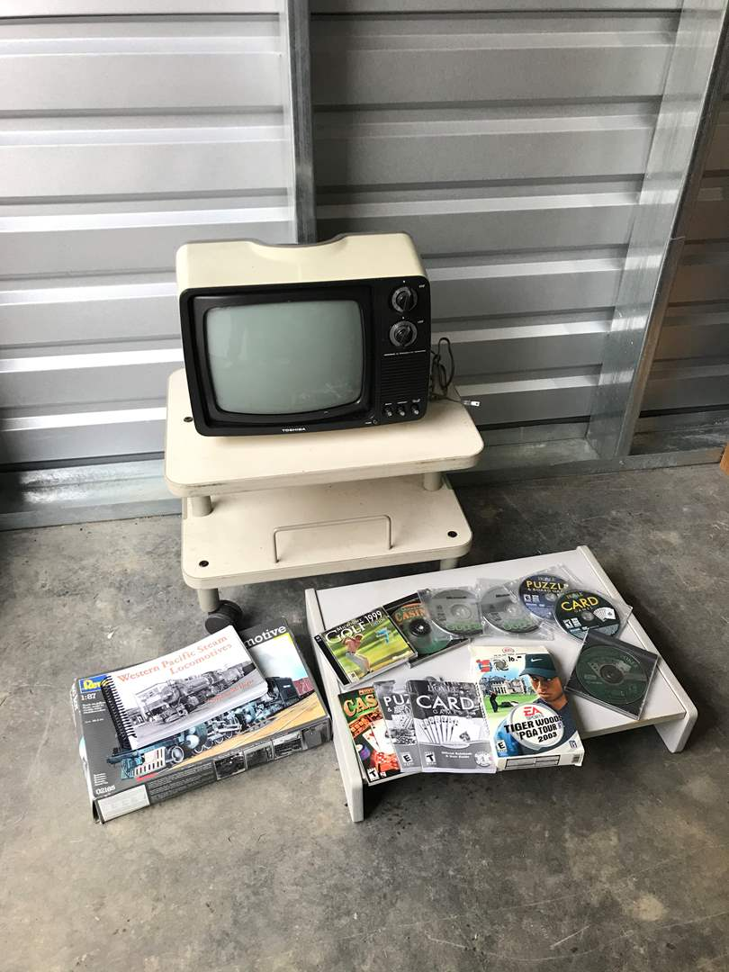Lot # 54 - Old Toshiba TV on Cart, Computer Games & Breakfast Tray  (main image)