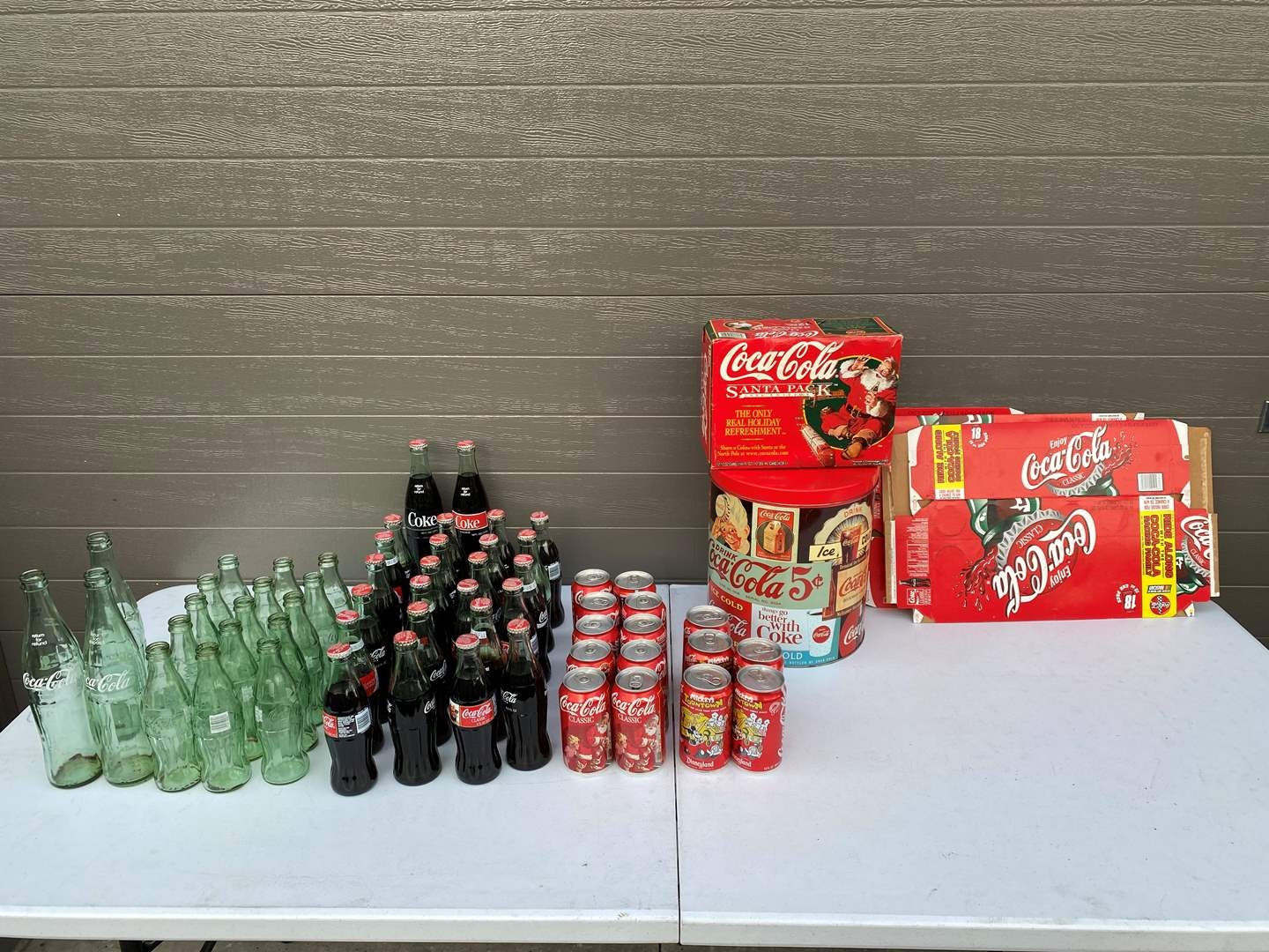 Lot # 92 - Collection of Coca-Cola Bottles, Cans, Tins, Empty Cases & More.. (main image)