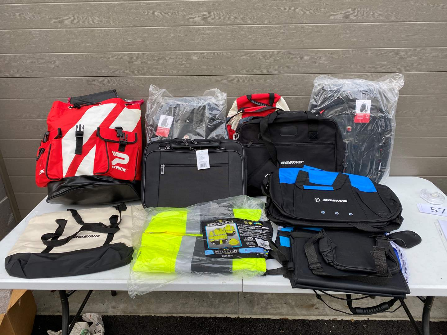 Lot # 58 - New Laptop Bags, Boeing Totes, New Safety Jackets & New Backpacks (main image)