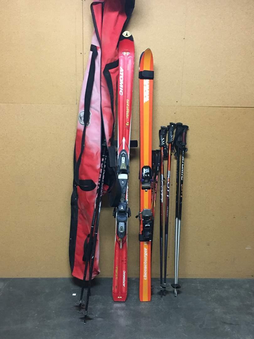 Lot # 134 - Two Pairs of Skiis and 4 pairs of Ski Poles  (main image)