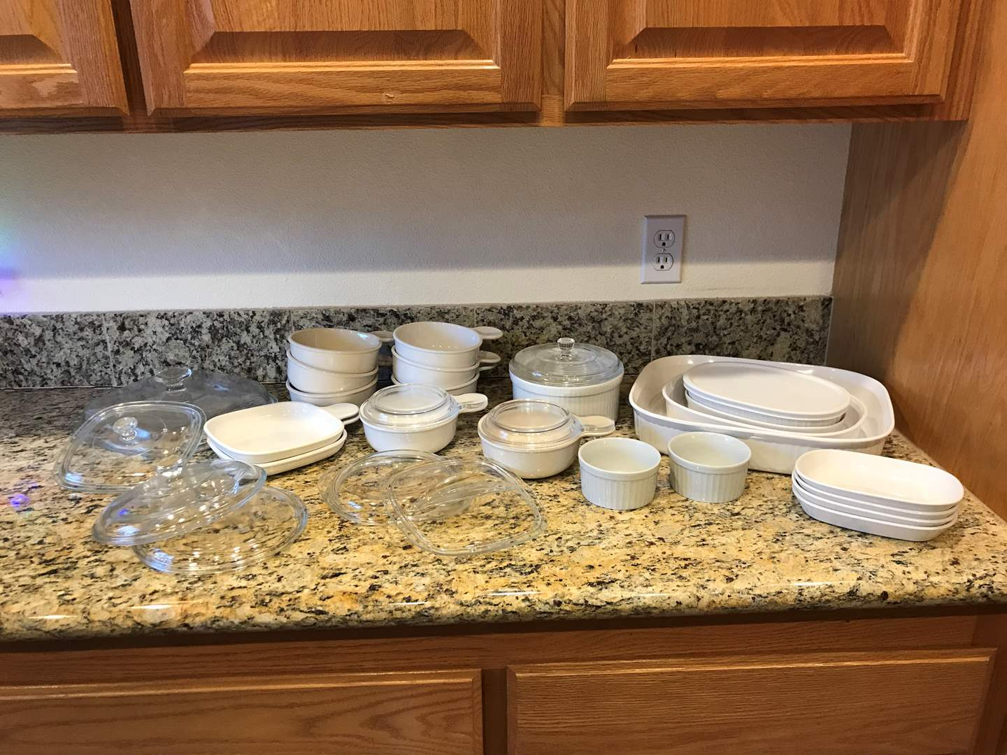 Lot # 50 - Selection of Corning Ware Casserole Dishes, Soup Bowls, Misc. Glass Lids & More.. (main image)
