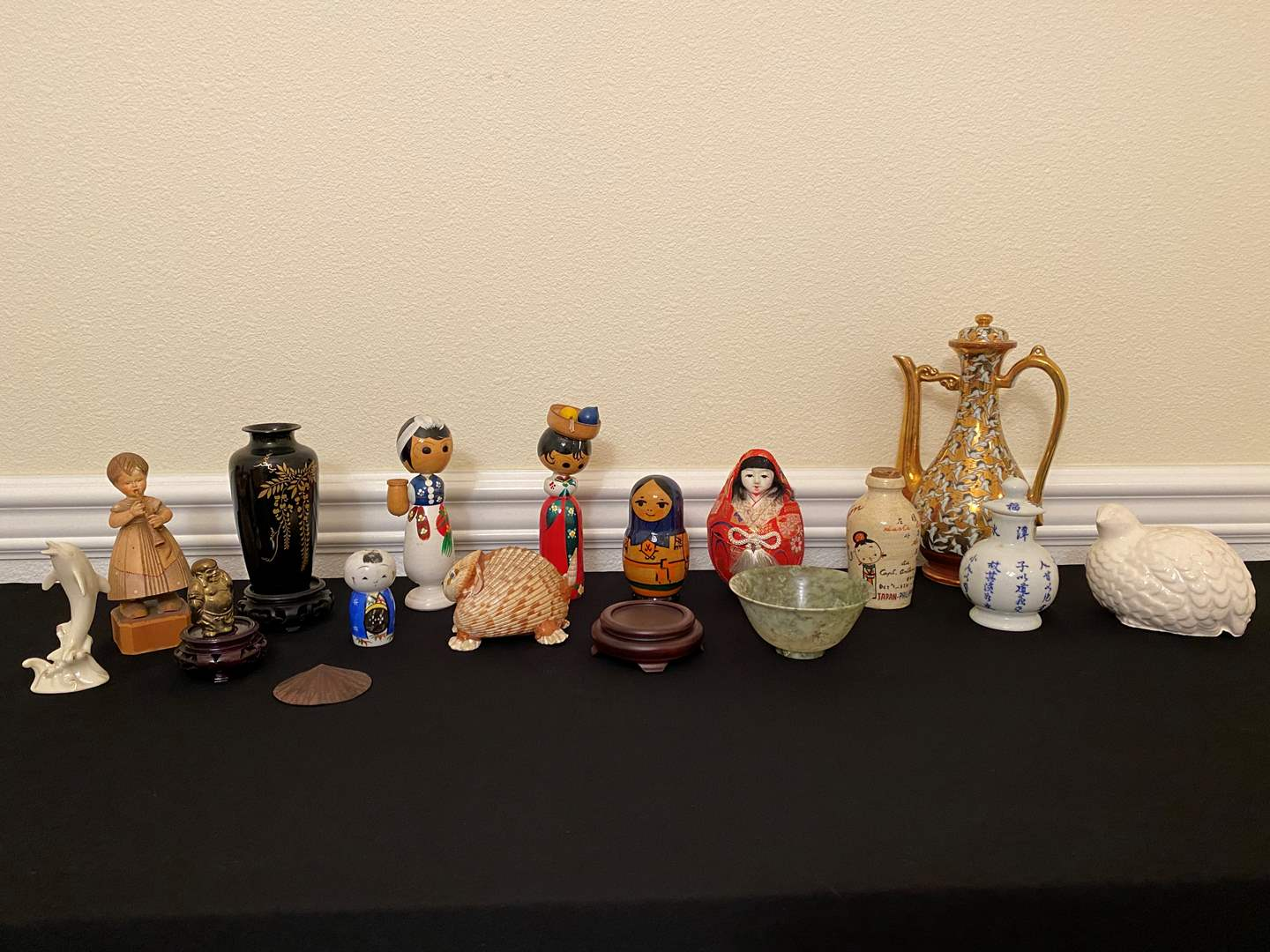 "Lot # 13 - Ceramic Asian Teapot, Jars, Asian Nesting Dolls, Wood Bobble Heads, Lenox Dolphin, Wood ""Arni"" Figurine & More.. (main image)"