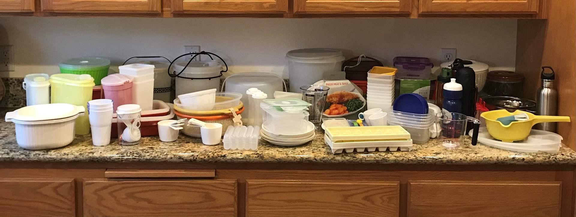 Lot # 61 - Large Plastic Lot: Tupperware Cake Case, Strainers, Snapware & More.. (main image)