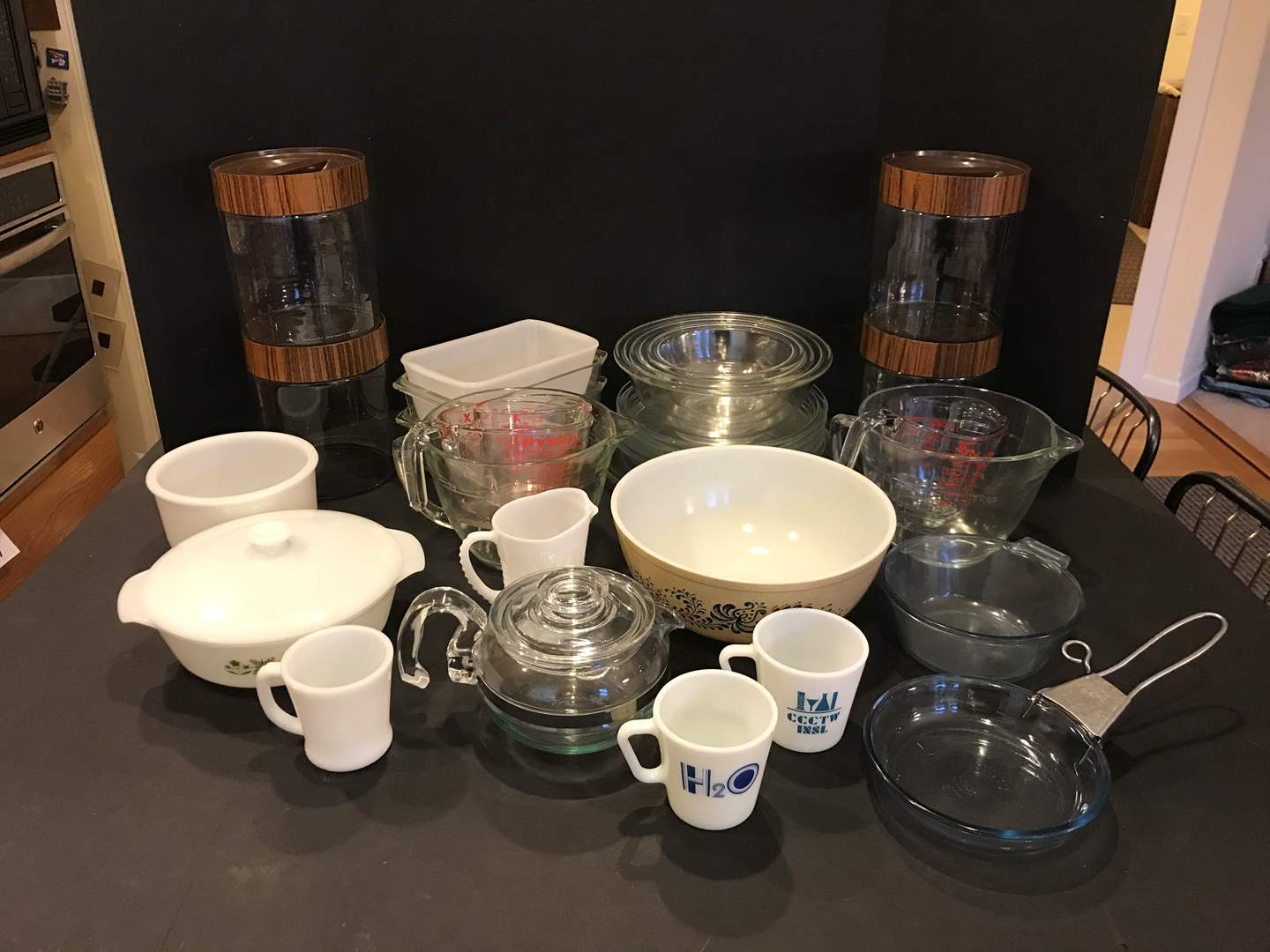 Lot # 91 - Large Selection of Pyrex: Mixing Bowls, Pie Plates, Canisters, Pyrex Flameware, Bread Pans & More.. (main image)