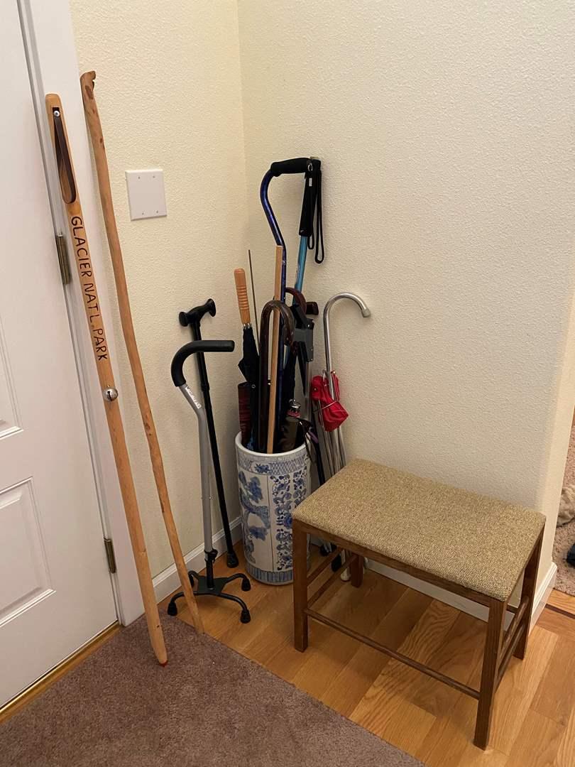 Lot # 148 - Ceramic Umbrella Holder Filled w/Walking Sticks, Canes, Umbrellas & Small Sitting Stool (main image)