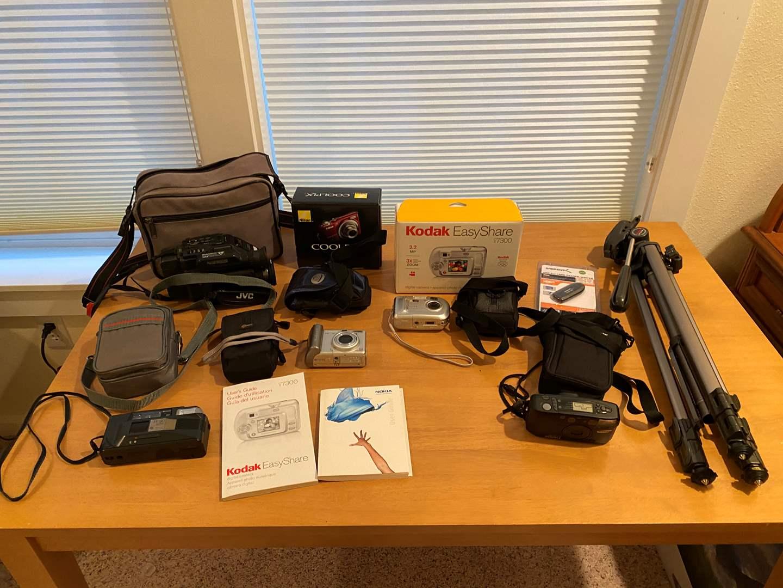 Lot # 196 - New Cool Pix L22, Kodak Easy Share, Cannon Power Shot, JVC Camcorder Tripod & More.. (main image)