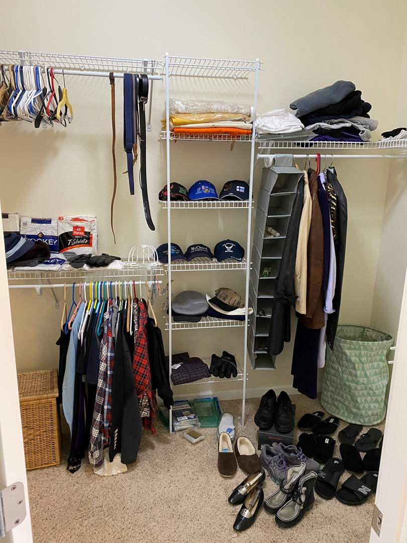 Lot # 216 - Closet Full of Men's & Women's Clothing: Hats, Leather Coats, New Shirts, Pants, Gloves & More..  (main image)