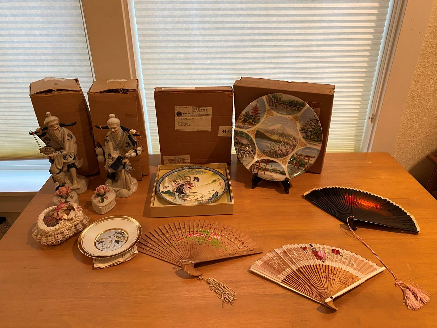 Lot # 220 - Asian Fans, Asian Collector Plates, Asian Ceramic Figurines & More.. (main image)