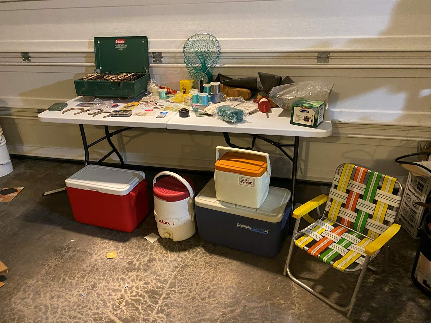 Lot # 347 - Camping & Fishing Items: Coleman Stove, Fishing Lines, Coleman Coolers, New Olympic Fly Reel 440, Waders & More.. (main image)