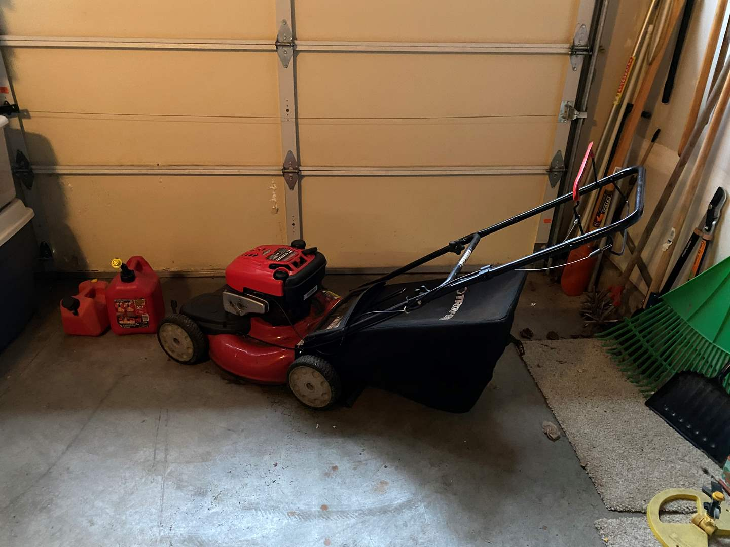 """Lot # 102 - Troy-Bilt 21"""" Self Propelled Mower w/Briggs & Stratton 190cc Motor & Two Gas Cans - Works (main image)"""