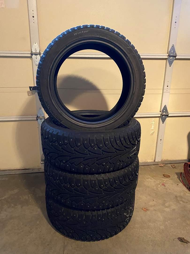 "Lot # 114 - Nice Set of 4 ""Hankook Winter Pike"" Studded Snow Tires - 225/45r17 94T (main image)"