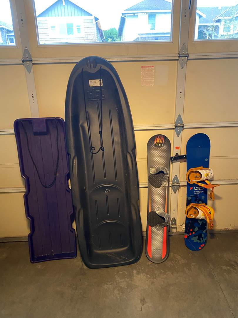 Lot # 130 - Two Child Size Snow Boards & Two Snow Sleds (main image)