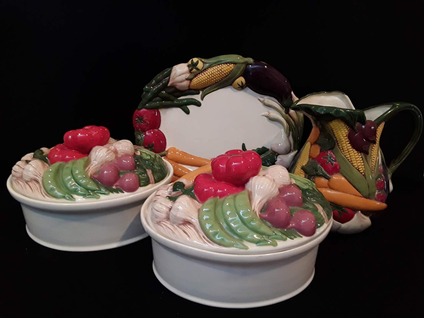 Lot # 101 - Set of four (4) Brightly Decorated Vegetable Pottery  (main image)