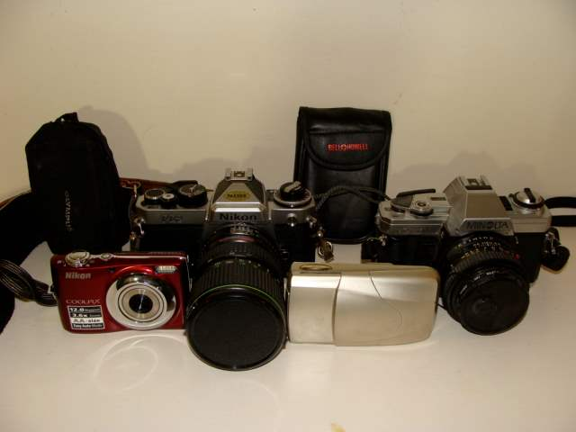 Lot # 86 - Lot of (4) Modern and Vintage Cameras (NIkon, Minolta, Olympus Panorama) (main image)